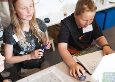 Børn lærer om boliger og demokrati i Minecraft